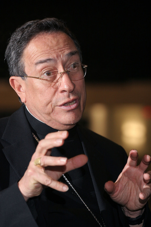 FILE - This July 12, 2006 file photo shows Honduran Cardinal Oscar Andres Rodriguez Maradiaga talking about the Catholic Church during an interview at Xavier University in Cincinnati.  The resignation of Pope Benedict XVI on Feb. 28, 2013 opens the door to a host of possible successors, from the cardinal of Milan to a contender from Ghana and several Latin Americans. (AP Photo/Tom Uhlman, file)