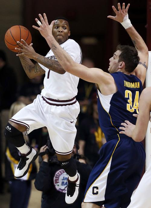 Arizona State's Jahii Carson (1) looks to pass around California's Robert Thurman (34) during the second half of an NCAA college basketball game, Thursday, Feb. 7, 2013, in Tempe, Ariz. Arizona State won 66-62. (AP Photo/Matt York)