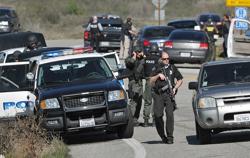 Redlands Police officers man a blockade  near the entrance to the San Bernardino National Forest in southern California after Christopher Dorner, a fugitive ex-Los Angeles cop sought in three killings, engaged in a shootout with authorities that wounded two officers in the San Bernardino Mountains near Big Bear Lake, Tuesday, Feb. 12, 2013. (AP Photo/The Sun, Gabriel Luis Acosta)  VENTURA COUNTY STAR OUT; RIVERSIDE PRESS-ENTERPRISE OUT; THE VICTOR VALLEY DAILY PRESS OUT