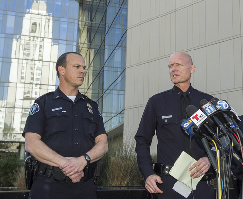 Los Angeles Police Commander Andrew Smith, right, briefs the media about the shootout scene in Big Bear that allegedly involves triple-murder suspect Christopher Jordan Dorner, during a news conference in front of the Police Administration Building in Los Angeles Tuesday, Feb. 12, 2013. At left,  Lt. Bill Whalen of the Irvine Police Department. (AP Photo/ Dovarganes)