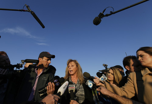 Cindy Bachman, Public Information officer for the San Bernardino County Sheriff's Department talks about the hunt for accused killer and fired Los Angeles police officer, Christopher Dorner in Yacaipa, Calif., Tuesday, Feb. 12, 2013. (AP Photo/Chris Carlson)