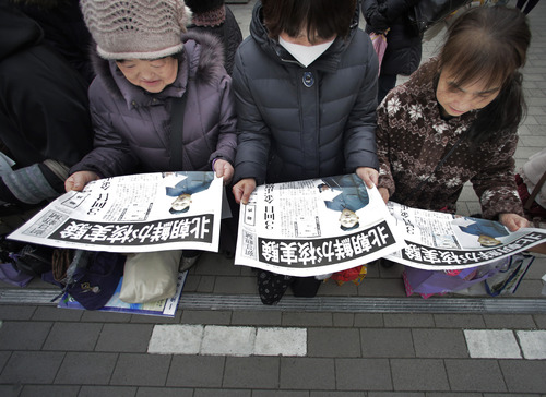 "Women read copies of a delivered extra edition of a Japanese newspaper reporting North Korea's nuclear test, in Tokyo Tuesday, Feb. 12, 2013. North Korea said it successfully detonated a miniaturized nuclear device at a northeastern test site Tuesday, defying U.N. Security Council orders to shut down atomic activity or face more sanctions and international isolation. The extra carrying a photo of North Korean leader Kim Jong Un reads: ""North Korea conducted a nuclear test."" (AP Photo/Itsuo Inouye)"