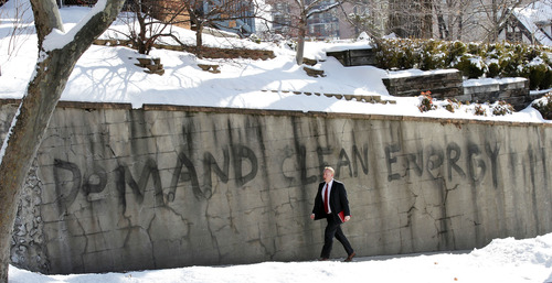 Al Hartmann  |  The Salt Lake Tribune A man walks up the hill to the Utah State Capitol at State Street and 200 North past wall grafitti Monday, Feb. 11, 2013.