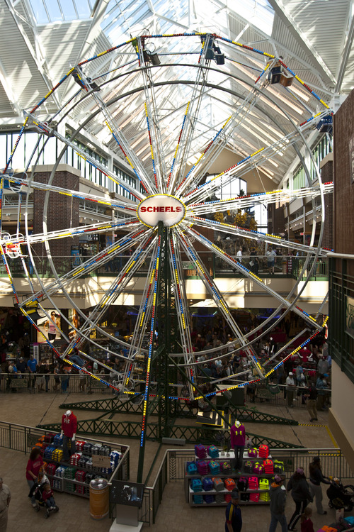 Chris Detrick  |  The Salt Lake Tribune Couples plan to marry on the Ferris wheel at Scheels on Thursday. Scheels opened its 220,000-square-foot mega-sporting goods store in Sandy in September. The store features a 16-car Ferris wheel rising toward a skylight among other attractions.