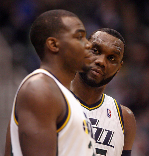 Steve Griffin | The Salt Lake Tribune   Utah's Paul Millsap, left, and Al Jefferson talk during a time out during a game against the Oklahoma City Thunder at EnergySolutions Arena in Salt Lake City on Tuesday, Feb. 12, 2013.
