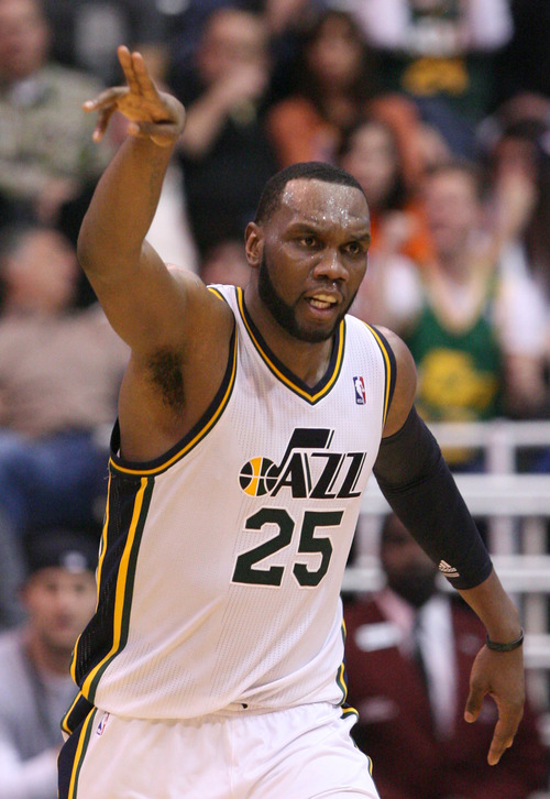 Steve Griffin | The Salt Lake Tribune   Utah's Al Jefferson holds his hand up after nailing a shot during a game against the Oklahoma City Thunder at EnergySolutions Arena in Salt Lake City on Tuesday, Feb. 12, 2013.