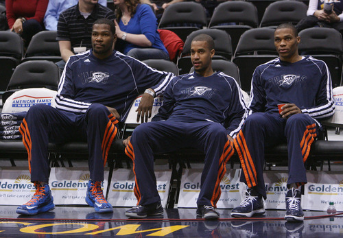 Steve Griffin | The Salt Lake Tribune   The Thunder's Kevin Durant, Eric Maynor and Russel Westbrook watch from the bench during warm-ups before a game against the Utah Jazz in Salt Lake City on Tuesday, Feb. 12, 2013.