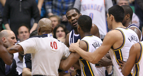Steve Griffin | The Salt Lake Tribune   The referees try to separate Jazz players from the Thunder's Kevin Durant after Durant fouled Utah's Alec Burks during a game in Salt Lake City on Tuesday, Feb. 12, 2013.