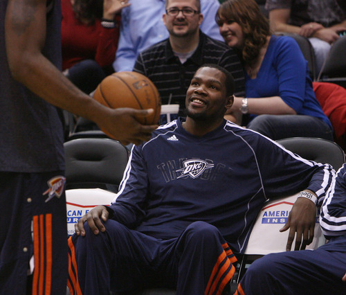 Steve Griffin | The Salt Lake Tribune   The Thunder's Kevin Durant laughs with a teammate during warm-ups before the game against the Utah Jazz at EnergySolutions Arena in Salt Lake City on Tuesday, Feb. 12, 2013.