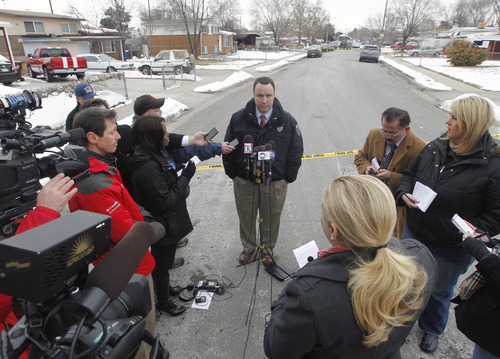 Al Hartmann  |  The Salt Lake Tribune Unified Police Lt. Justin Hoyal says Tuesday that David Fresques, a person of interest in a Midvale triple homicide, is still at large. Up to 80 officers are involved in a manhunt.