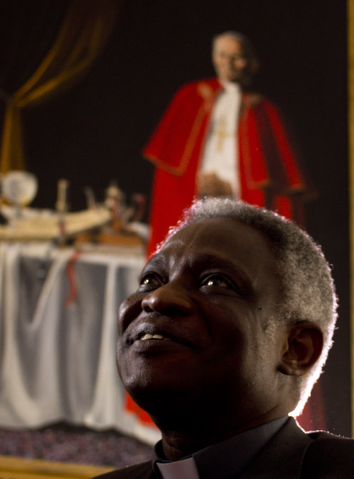 Ghanian Cardinal Peter Kodwo Appiah Turkson talks to the Associated Press during an interview, in Rome, Tuesday, Feb. 2013. One of Africa's brightest hopes to be the next pope, Ghanian Cardinal Turkson, says the time is right for a pontiff from the developing world. In the background is a painting of late Pope John Paul II.  (AP Photo/Domenico Stinellis)