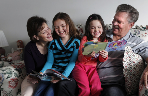 Al Hartmann  |  The Salt Lake Tribune Vickie and Ray Ipson read chapter books with their grandchildren Civic, 9 and Genessa, 7, They are rasing them and have legally adopted them after their daughter lost custody of the two girls. The Ipsons credit the Grandfamilies program with helping them deal with their new reality.