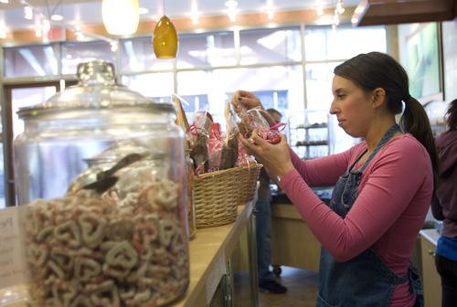 Kim Raff  |  The Salt Lake Tribune Allie Humphrey readies gift baskets at Rocky Mountain Chocolate Factory in Lehi on February 7, 2013.