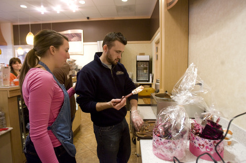 Kim Raff  |  The Salt Lake Tribune Matt Canaday and Allie Humphrey, prepping treats earlier this week at Rocky Mountain Chocolate Factory in Lehi, opened their shop last fall.