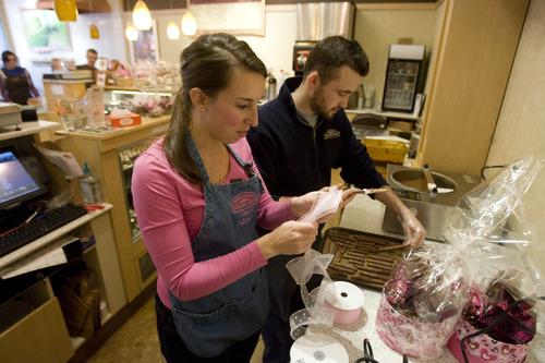 Kim Raff  |  The Salt Lake Tribune Matt Canaday and Allie Humphrey prep treats at Rocky Mountain Chocolate Factory in Lehi earlier this week.