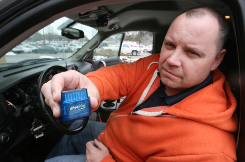 Steve Griffin | The Salt Lake Tribune   Allstate Insurance agent Adam Ware holds a prototype DriveWise device that he has been using in his personal car for the past few months. Allstate plans to roll out their DriveWise program which uses the device to measure customers' driving habits and charge them premiums based on the results. He was photographed outside his  Sandy, Utah office Tuesday February 12, 2013.