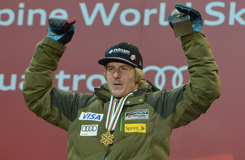 Gold medal winner Ted Ligety, of the United States, reacts during the medal ceremony of men's super-combined at the Alpine skiing world championships in Schladming, Austria, Wednesday, Feb. 13, 2013. (AP Photo/Kerstin Joensson)
