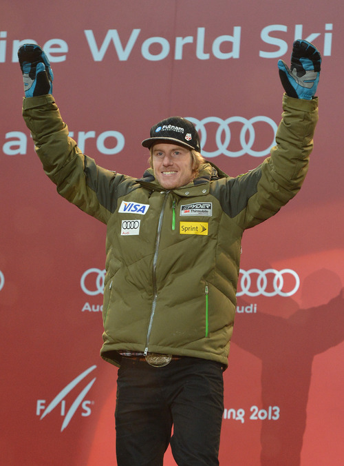 Gold medal winner Ted Ligety of the United States reacts during the medal ceremony of men's super-combined at the Alpine skiing world championships in Schladming, Austria, Wednesday, Feb. 13, 2013. (AP Photo/Kerstin Joensson)