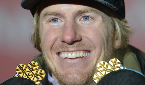 Gold medal winner Ted Ligety, of the United States, poses with the  gold medals he won in the men's super-combined and men's super-G at the Alpine skiing world championships in Schladming, Austria, Wednesday, Feb. 13, 2013. (AP Photo/Kerstin Joensson)