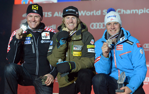 Ted Ligety, the winner, of the United States, center, poses with his gold medal flanked by Croatia's  silver medalist Ivica Kostelic, left, and Austria's bronze medal winner Romed Baumann during the medal ceremony of the men's super-combined  at the Alpine skiing world championships in Schladming, Austria, Wednesday, Feb. 13, 2013. (AP Photo/Kerstin Joensson)