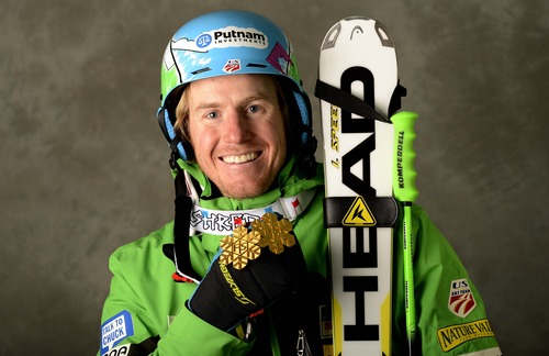 In this photo provided by Schladming 2013 Wednesday, Feb. 13, 2013, Ted Ligety, of the United States, poses with the gold medals of the men's super-G and the men's super-combined, at the Alpine Skiing world championships in Schladming, Austria. (AP Photo/Erich Spiess, Schladming 2013)