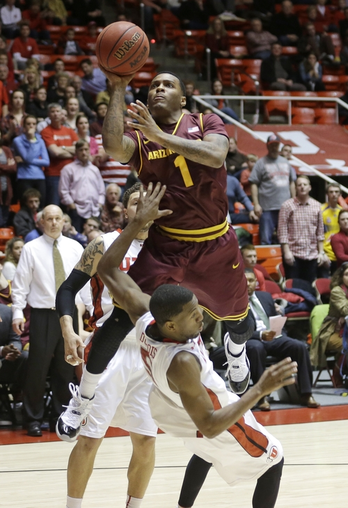 Arizona State's Jahii Carson (1) fouls Utah's Jarred DuBois (5) on the way to the basket in the second half during an NCAA college basketball game Wednesday, Feb. 13, 2013, in Salt Lake City. Utah defeated Arizona State 60-55. (AP Photo/Rick Bowmer)