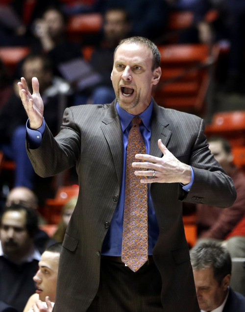 Utah head coach Larry Krystkowiak shouts to his team in the first half during an NCAA college basketball game against Arizona State on Wednesday, Feb. 13, 2013, in Salt Lake City. (AP Photo/Rick Bowmer)