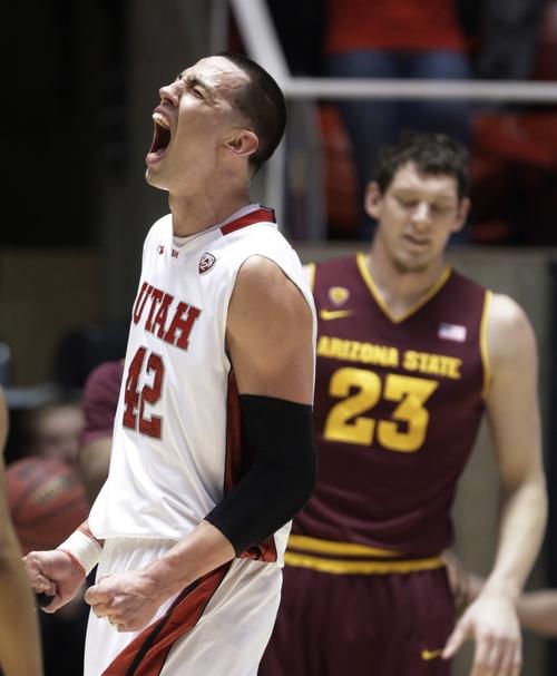 Utah's Jason Washburn (42) shouts after scoring while Arizona State's Ruslan Pateev (23) watches in the first half during an NCAA college basketball game Wednesday, Feb. 13, 2013, in Salt Lake City. (AP Photo/Rick Bowmer)