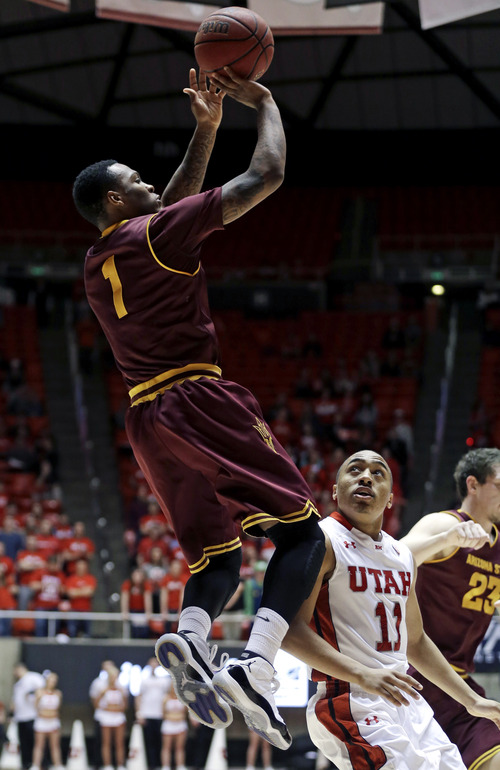 Arizona State's Jahii Carson (1) shoots as Utah's Brandon Taylor (11) watches in the first half during an NCAA college basketball game Wednesday, Feb. 13, 2013, in Salt Lake City. (AP Photo/Rick Bowmer)