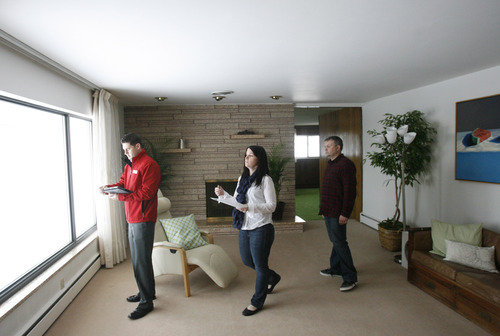 Rick Egan  | The Salt Lake Tribune   Real estate agent, Mark Numbers, left, shows  a home to Jami and Scott Holdaway, in Salt Lake City with Wednesday, February 13, 2013.