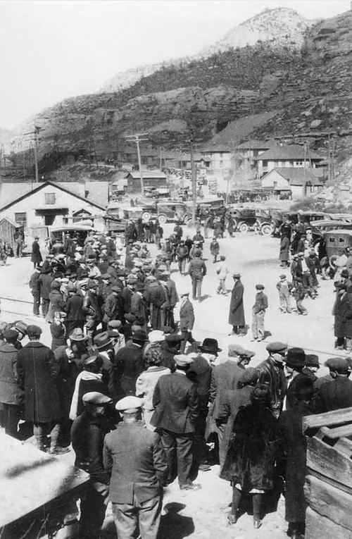 Photo courtesy of Utah State Historical Society Groups gathered on the streets of Castle Gate during a mining disaster that killed 172 men and left 417 dependents. Castle Gate was a coal mining community settled in 1888. The town survived for almost a century until 1974 when it was dismantled due to expanded mining operations.