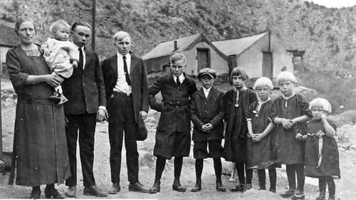 Photo courtesy of Utah State Historical Society Widow and children of O.H. Rollins of Castle Gate, who died in the mine explosion in 1924 that killed 172 men and left 417 dependents. Mrs. Rollins, left, Verzells, 1, Irsi, 17, Lafayette, 14, Orson Jr., 12, Joseph, 11, Vera, 9, Eliza, 7, Viola, 5, Iona, 3. Another child was expected in May, two months from the date of this photograph.
