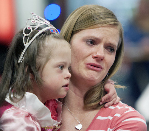 Steve Griffin  |  The Salt Lake Tribune With her adopted daughter, Jaymi Bonner, in her arms, Jeana Bonner cries as she talks to reporters at the main terminal at the Salt Lake City International Airport in Salt Lake City, Utah Thursday, February 14, 2013. The mother and daugher arrived home today after weeks spent in Russia trying to finalize the adoption of 5-year-old Jaymi, who has Down syndrome. The Russian government in January approved a ban on adoptions by U.S. citizens, but agreed to let adoptions that were already basically completed to proceed. This was one of about 50 adoptions allowed to move forward.