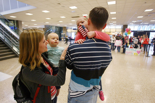Steve Griffin  | The Salt Lake Tribune Jaymi Bonner, hugs her father, Wayne Bonner, as she meets him and her sister, Bryne, after arriving with her mother, Jeana, at the main terminal at the Salt Lake City International Airport in Salt Lake City, Utah Thursday, February 14, 2013. The mother and daughter arrived home after weeks spent in Russia trying to finalize the adoption of 5-year-old Jaymi, who has Down syndrome. The Russian government in January approved a ban on adoptions by U.S. citizens, but agreed to let adoptions that were already basically completed to proceed. This was one of about 50 adoptions allowed to move forward.