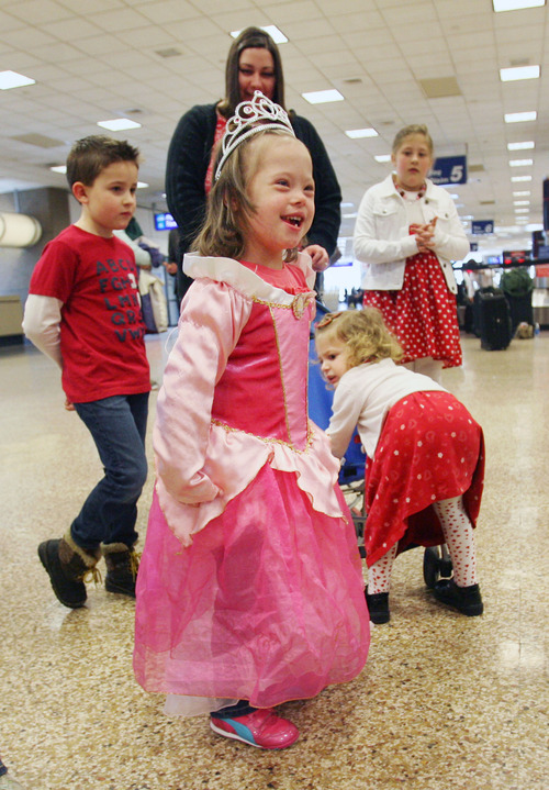 Steve Griffin |  The Salt Lake Tribune Jaymi Bonner runs around in her new princess dress at the main terminal at the Salt Lake City International Airport  in Salt Lake City, Utah Thursday, February 14, 2013. Jaymi and her mother, Jeana Bonner, arrived home today after weeks spent in Russia trying to finalize the adoption of 5-year-old Jaymi, who has Down syndrome. The Russian government in January approved a ban on adoptions by U.S. citizens but agreed to let adoptions that were already basically completed to proceed. This was one of about 50 adoptions allowed to move forward.