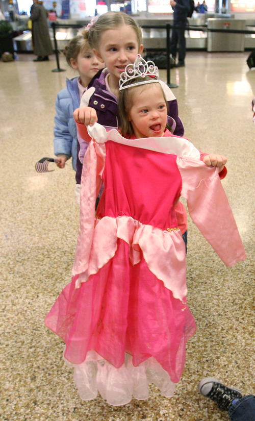 Steve Griffin  |  The Salt Lake Tribune Jaymi Bonner runs around with her new princess dress at the main terminal at the Salt Lake City International Airport in Salt Lake City, Utah Thursday, February 14, 2013. Jaymi and her mother, Jeana Bonner, arrived home after weeks spent in Russia trying to finalize the adoption of 5-year-old Jaymi, who has Down syndrome. The Russian government in January approved a ban on adoptions by U.S. citizens, but agreed to let adoptions that were already basically completed to proceed. This was one of about 50 adoptions allowed to move forward.