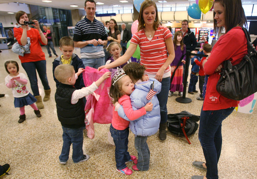Steve Griffin  |  The Salt Lake Tribune Jaymi Bonner, center, gets a big hug from her new cousin, Jackie Rasmussen, at the main terminal at the Salt Lake City International Airport in Salt Lake City, Utah Thursday, February 14, 2013. Jaymi and her mother, Jeana Bonner, arrived home after weeks spent in Russia trying to finalize the adoption of 5-year-old Jaymi, who has Down syndrome. The Russian government in January approved a ban on adoptions by U.S. citizens, but agreed to let adoptions that were already basically completed to proceed. This was one of about 50 adoptions allowed to move forward.