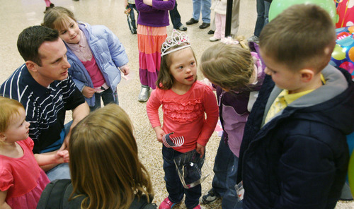 Steve Griffin  |  The Salt Lake Tribune Jaymi Bonner, center, meets her new cousins at the main terminal at the Salt Lake City International Airport  in Salt Lake City, Utah Thursday, February 14, 2013. Jaymi and her mother, Jeana Bonner, arrived home after weeks spent in Russia trying to finalize the adoption of 5-year-old Jaymi, who has Down syndrome. The Russian government in January approved a ban on adoptions by U.S. citizens, but agreed to let adoptions that were already basically completed to proceed. This was one of about 50 adoptions allowed to move forward.