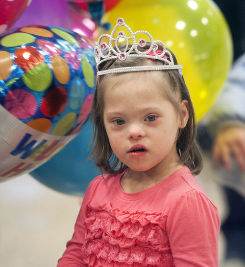 Steve Griffin  |  The Salt Lake Tribune Jaymi Bonner wears a tiara after arriving at Salt Lake City International Airport in Salt Lake City, Utah Thursday, February 14, 2013. Jaymi and her mother, Jeana Bonner, arrived home after weeks spent in Russia trying to finalize the adoption of 5-year-old Jaymi, who has Down syndrome. The Russian government in January approved a ban on adoptions by U.S. citizens, but agreed to let adoptions that were already basically completed to proceed. This was one of about 50 adoptions allowed to move forward.