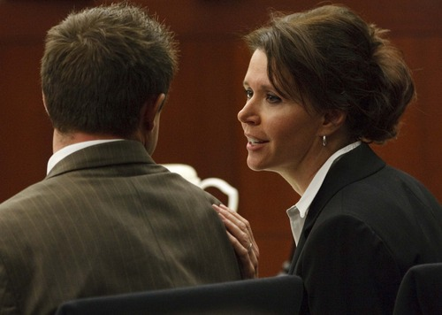 Leah Hogsten  |  The Salt Lake Tribune Robert Cole Boyer is patted on the back by defense attorney Rebecca Skordas after Boyer's testimony Thursday, Feb. 14, 2013, as his trial continued in Ogden's 2nd District Courthouse with Judge Ernie Jones presiding. Colton Raines and Robert Cole Boyer are two of three men charged in a boating accident last summer on Pineview Reservoir that killed swimmer Esther Fujimoto.