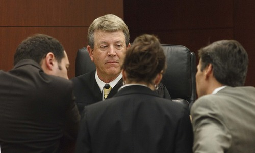 Leah Hogsten  |  The Salt Lake Tribune Ogden's 2nd District Court Judge Ernie Jones looks to prosecution attorney Teral Tree, left, and defense attorneys Rebecca and Greg Skordas as the three review questions from the jurors to be asked of Colton Raines, who took the stand Thursday, Feb. 14, 2013. Colton Raines and Robert Cole Boyer are two of three men charged in a boating accident last summer on Pineview Reservoir that killed swimmer Esther Fujimoto.