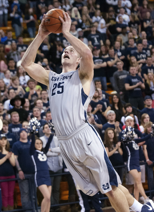 Utah State's Jordan Stone shoots against Denver during the first half of their NCAA college basketball game, Thursday, Feb. 14, 2013, in Logan, Utah. Denver won 63-60 in overtime. (AP Photo/The Herald Journal, Jennifer Meyers)