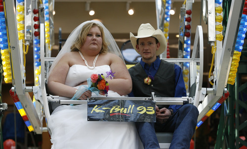 Rick Egan  |  The Salt Lake Tribune  James Bytendorp and Kelli Silcox sit on the Ferris wheel at Scheels before being married by Murray Mayor Dan Snarr on Thursday.