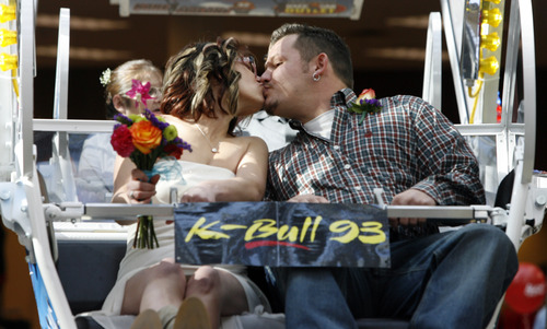 Rick Egan  |  The Salt Lake Tribune  Kirt and Jana Williams kiss on the Ferris wheel at Scheels on Thursday.