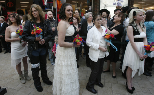Rick Egan  |  The Salt Lake Tribune  Brides wait to board the Ferris wheel at Scheels on Thursday.