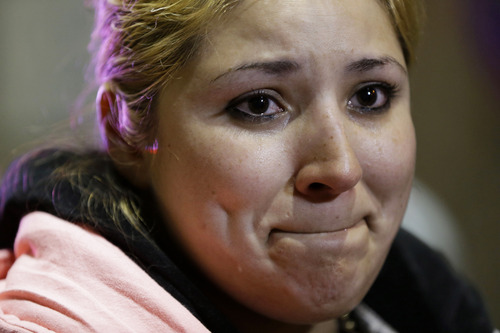 Maria Hernandez, of Angleton, Texas, a passenger from the disabled Carnival Triumph cruise ship, tears up as she describes the ordeal to reporters after arriving by bus at the Hilton Riverside Hotel in New Orleans, Friday, Feb. 15, 2013. The ship had been idled for nearly a week in the Gulf of Mexico following an engine room fire. (AP Photo/Gerald Herbert)