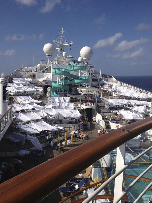 This undated photo provided by passenger Don Hoggatt, of Dallas, shows the tent city built on the Lido deck of the Carnival Triumph cruise ship for people to spend the day or night in to escape the stench from the lower decks of the disabled ship. The Triumph arrived late Thursday, Feb. 14, 2013, in Mobile, Ala., after an engine-room fire left the ship powerless off Mexico last weekend. (AP Photo/Don Hoggatt)