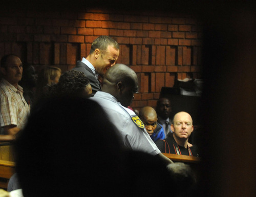 South African athlete Oscar Pistorius reacts,  in court in Pretoria, South Africa, Friday, Feb 15, 2013, at his bail hearing in the murder case of his girlfriend Reeva Steenkamp.  Pistorius was formally charged at Pretoria Magistrate's Court with one count of murder after his girlfriend, Reeva Steenkamp, a model and budding reality TV show participant, was shot multiple times and killed at Pistorius' upmarket home in the predawn hours of Thursday.  (AP Photo/Antione de Ras - Independent Newspapers Ltd South Africa-Star) SOUTH AFRICA OUT. NO MAGS