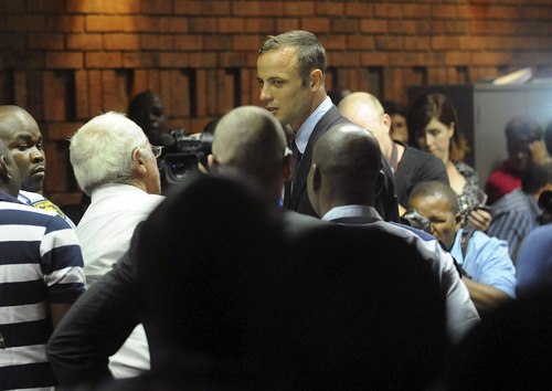 South African athlete Oscar Pistorius at the end of court proceedings,  in Pretoria, South Africa, Friday, Feb 15, 2013. Pistorius was formally charged at Pretoria Magistrate's Court with one count of murder after his girlfriend, Reeva Steenkamp, a model and budding reality TV show participant, was shot multiple times and killed at Pistorius' upmarket home in the predawn hours of Thursday. (AP Photo/Antione de Ras - Independent Newspapers Ltd South Africa-Star) SOUTH AFRICA OUT