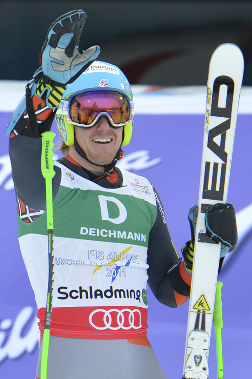 United States's Ted Ligety celebrates winning the gold medal after the second run of the men's giant slalom  at the Alpine skiing world championships in Schladming, Austria, Friday, Feb. 15, 2013. (AP Photo/Kerstin Joensson)